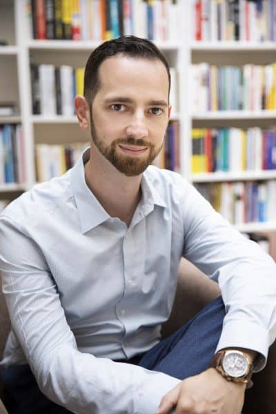 Mikkel Thorup sitting in his office in front of books